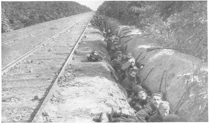 Allied troops digging in by the side of a railway