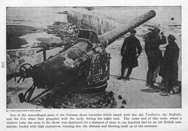 One of the camouflaged guns of the German shore batteries which raked with fire the Vindictive, the Daffodil, and the Iris when they grappled with the mole, during the night raid.