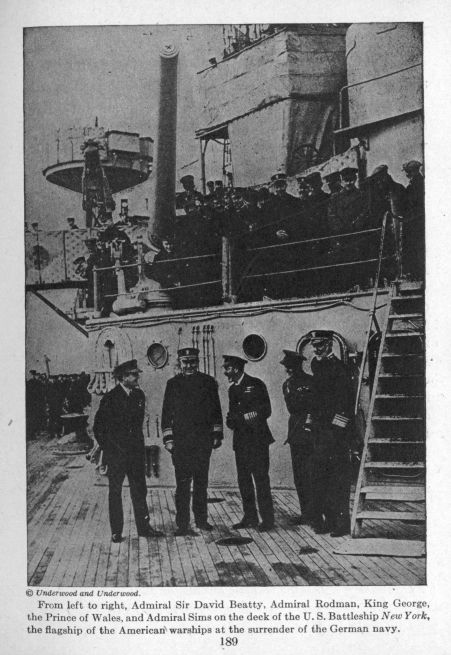 From left to right, Admiral Sir David Beatty, Admiral Rodman, King George, the Prince of Wales, and Admiral Sims on the deck of the U.S. Battleship New York,