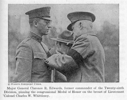 Major General Clarence R. Edwards pinning the congressional Medal of Honor on the breast of Lieutenant Colonel Charles W. Whittlesey.
